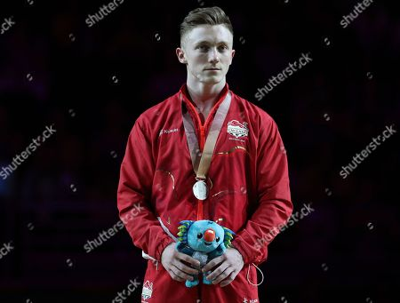 Men's parallel bars silver medalist Nile Wilson of England during the medal ceremony at the artistic gymnastics competition at the Commonwealth Games at Coomera Indoor Stadium on the Gold Coast, Australia