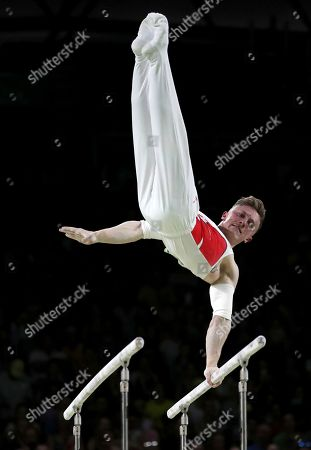 Nile Wilson of England competes in the men's parallel bars final during the artistic gymnastics competition at the Commonwealth Games at Coomera Indoor Stadium on the Gold Coast, Australia