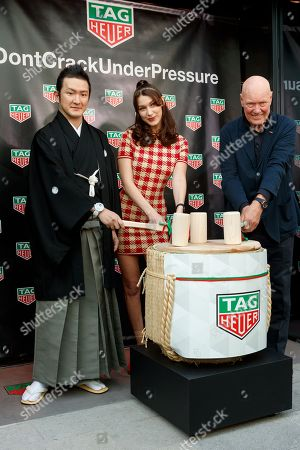 (L to R) Japanese kabuki actor Shido Nakamura, Bella Hadid and Jean-Claude Biver President and CEO of TAG Heuer