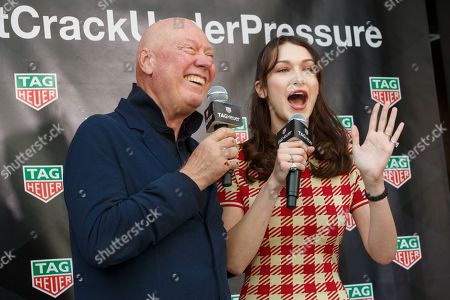 Stock Photo of Bella Hadid (R) and Jean-Claude Biver President and CEO of TAG Heuer