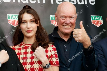 Stock Image of Bella Hadid (R) and Jean-Claude Biver President and CEO of TAG Heuer