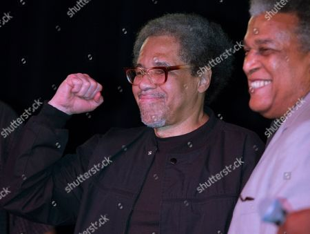 """Albert Woodfox pumps his fist as he arrives on stage during his first public appearance at the Ashe Cultural Arts Center with Parnell Herbert, right, in New Orleans, after his released from Louisiana State Penitentiary in Angola, La. earlier in the day. Woodfox is the last of three high-profile Louisiana prisoners known as the """"Angola Three"""" to be released"""