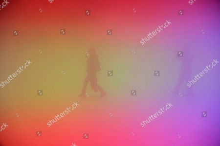 """Visitors try to find their way inside an installation art work entitled """"Feelings are Facts,"""" jointly produced by Danish-Icelandic artist Olafur Eliasson and Chinese artist Ma Yansong, in Beijing, China, . The art form uses lights, mist and temperature to create artificial environments, with the goal of challenging the viewer's relationship with both nature and urban environment"""