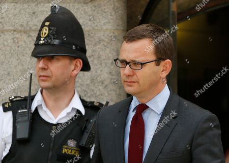 Andy Coulson, former News of the World editor and the former spin doctor of British Prime Minister David Cameron, leaves the Central Criminal Court in London, . Coulson was convicted of phone hacking Tuesday, but fellow editor Rebekah Brooks was acquitted after a monthslong trial centering on illegal activity at the heart of Rupert Murdoch's newspaper empire. A judge on Wednesday dismissed the jury at Britain's phone-hacking trial after it failed to reach a verdict on two final counts, having convicted him of hacking a day earlier. Judge John Saunders ended the trial after jurors said they could not agree whether Coulson and ex-royal editor Clive Goodman were guilty of paying police officers for royal phone directories. Prosecutors said they would announce next week whether they would seek a retrial