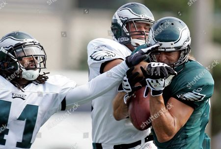 Riley Cooper, Antoine Harris, Ryan Hamilton. Philadelphia Eagles wide receiver Riley Cooper, right, fights off safety Antoine Harris (41) and Ryan Hamilton, center, as he makes a catch during the morning session at NFL football training camp at Lehigh University in Bethlehem, Pa. on Saturday, July, 31, 2010