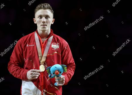Men's horizontal bar gold medalist Nile Wilson on the podium at the artistic gymnastics competition at the Commonwealth Games at Coomera Indoor Stadium on the Gold Coast, Australia