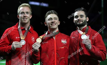 Nile Wilson, Cory Paterson, James Hall. Men's horizontal bar gold medalist Nile Wilson, left, of England stands with dual silver medalists Canada's Cory Paterson and England's James Hall, left, on the podium at the artistic gymnastics competition at the Commonwealth Games at Coomera Indoor Stadium on the Gold Coast, Australia