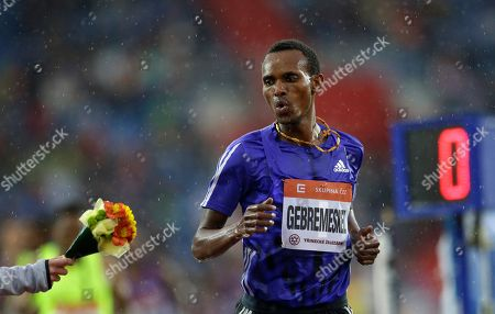 Dejen Gebremeskel from Ethiopia receives flowers after winning the 5000 meters men event at the Golden Spike Athletic meeting in Ostrava, Czech Republic