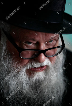 Austria's artist Hermann Nitsch speaks during an interview with The Associated Press at the Superior Art Institute in Havana, Cuba, . Nitsch is in Cuba to attend the Havana Biennial Art Exhibition in May and June