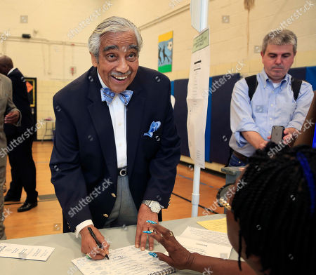 Harlem Rep. Charles Rangel looks up at reporters while voting in New York, . Nine Democrats are running to replace Rangel and five more on Long Island are competing for Rep. Steve Israel's seat in New York congressional primary elections Tuesday