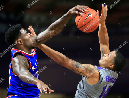 Jamari Traylor, Justin Edwards. Kansas forward Jamari Traylor, left, blocks a shot by Kansas State guard Justin Edwards (14) during the first half of an NCAA college basketball game in Manhattan, Kan