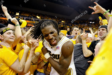 Missouri's DeMarre Carroll, center, is surrounded by fans as they rush the court after Missouri defeated Kansas 62-20 in an NCAA college basketball game, in Columbia, Mo. Carroll led all scorers with 22 points