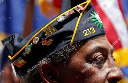 American Legion member Richard Clark, wearing his association pins on his cover, participates in the annual Memorial Day observances at the Vicksburg National Cemetery, in Vicksburg, Miss