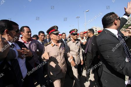 Sami Anan, Hussein Tantawi. Egyptian Gen. Sami Anan, center, and Field Marshal Hussein Tantawi, who heads Egypt's powerful military council, second from right, attend the funeral for Egypt's former spy chief, Omar Suleiman in Cairo, Egypt, . Egypt's top military commander and mourners attended a military funeral honoring Egypt's former spy chief Omar Suleiman, who died in a U.S. hospital at the age of 76