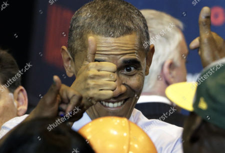 President Barack Obama gives a thumbs up to supporters as he campaigns for Wisconsin Democratic gubernatorial candidate Mary Burke during a rally at the North Division High School, in Milwaukee