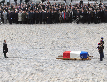 France's President Nicolas sarkozy, left, stands before the coffin to pay homage to the Raymond Aubrac, a major figure of the French Resistance during the war, who has died, aged 97, during a ceremony, in Paris, France. Aubrac gained renown when he evaded the Nazis in a now-legendary escape led by his equally renowned wife