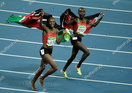 Kenya's gold medal winner Vivian Jepkemoi Cheruiyot, right, and Kenya's Hellen Onsando Obiri celebrate after the women's 5000-meter final, during the athletics competitions at the 2016 Summer Olympics in Rio de Janeiro, Brazil