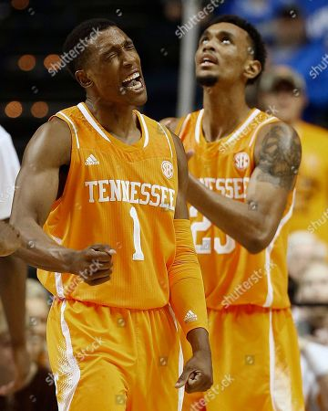 Tennessee guard Josh Richardson (1) celebrates a basket against Vanderbilt as Tennessee forward Derek Reese (23) look son during the second half of an NCAA college basketball game in the second round of the Southeastern Conference tournament, in Nashville, Tenn. Tennessee won 67-61