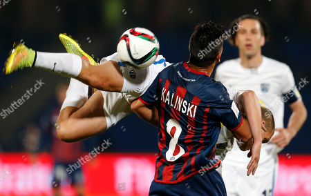 San Lorenzo's Enzo Kalinski battles for the ball with Auckland City FC's John Irving during the semi final soccer match between Auckland City FC and San Lorenzo at the Club World Cup soccer tournament in Marrakech, Morocco