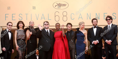From left, jury members Ethan Coen, Sophie Marceau, Rossy de Palma, Guillermo Del Toro, Rokia Traore, Xavier Dolan, Sienna Miller, Jake Gyllenhaal and Joel Coen pose for photographers as they arrive for the opening ceremony and the screening of the film La Tete Haute (Standing Tall) at the 68th international film festival, Cannes, southern France