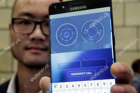 Stock Image of Jonathan Wong of Samsung's Knox Product Marketing, shows the iris scanner feature of the Galaxy Note 7, in New York. Each year, phones get faster processors, better cameras and longer battery life. Improvements are so common that it's rare for phone launches to generate excitement anymore, especially for Android, when all models have the same underlying Google software. Samsung is hoping to stand out and encourage upgrades by giving its new Galaxy Note 7 phone an iris scanner and security features
