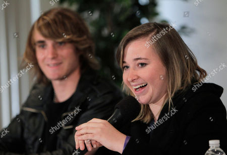Abby Sunderland, the 16-year-old girl who attempted to sail around the world, speaks as she is joined by her brother Zac during a news conference in Marina Del Rey, Calif., . Sunderland was rescued by a French fishing boat after her boat became crippled by storms while trying to become the youngest person to circumnavigate the globe solo and nonstop