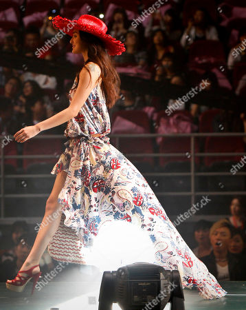 Japanese model Jun Hasegawa showcases fashion produced by Lovedrose during the Tokyo Girls Collection fashion show held in Beijing . The Tokyo-originated fashion festival where non-professional audience can make a purchase on the spot through the mobile phone site, was held for the first time for Chinese people in the street