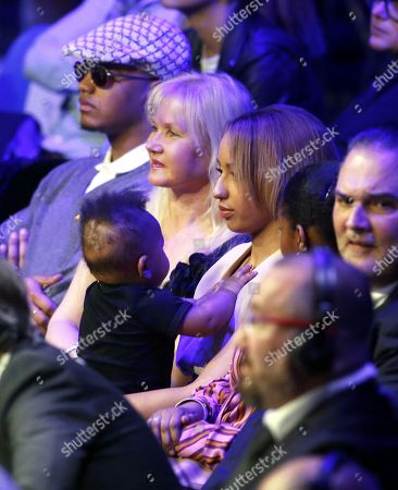 Tony Yoka's wife, French boxer Estelle Mossely, with her son