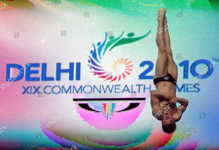 Australia's Matthew Mitcham dives to win the silver medal in the men's 10m platform diving final during the Commonwealth Games at the Dr. S.P. Mukherjee Aquatics Center in New Delhi, India