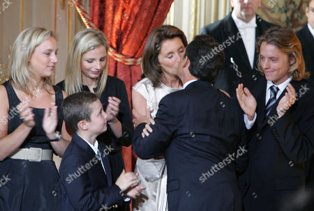 Nicolas Sarkozy, Cecilia Sarkozy, Judith Martin, Jeanne-Marie Martin, Louis Sarkozy, Jean Martin. New French President Nicolas Sarkozy, 2nd from right, kisses his wife Cecilia as their children applaud at the Elysee Palace, in Paris, . From left Sarkozy's stepdaughters Judith and Jeanne-Marie Martin, Sarkozy's sons Louis, bottom, and Jean, right. Sarkozy officially takes office Wednesday as France's new president, replacing Jacques Chirac in an elaborate ceremony at the Elysee Palace