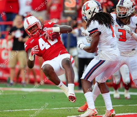 Trey Foster, Jaylen Dunlap, Taylor Barton. Nebraska tight end Trey Foster (42) scores a touchdown against Illinois defensive backs Jaylen Dunlap (1) and Taylor Barton (3) during the second half of an NCAA college football game in Lincoln, Neb., . Nebraska won 31-16