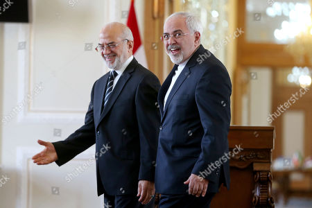 Mohammad Javad Zarif, Ibrahim al-Jafari. Iranian Foreign Minister Mohammad Javad Zarif, right, and his Iraqi counterpart Ibrahim al-Jafari depart after their joint press conference in Tehran, Iran