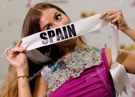 Miss Universe contestant Desire Cordero, of Spain, poses for a photo after a news conference for contestants from Latin America and Spain, in Doral, Fla. The Miss Universe pageant will be held on Jan. 25, in Miami