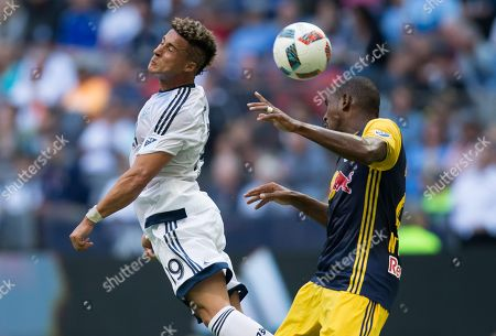Erik Hurtado, Ronald Zubar. Vancouver Whitecaps' Erik Hurtado, left, and New York Red Bulls' Ronald Zubar vie for the ball during first-half MLS soccer game action in Vancouver, British Columbia