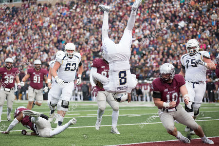 Montana State quarterback Chris Murray (8) flips into the end zone for a touchdown against Montana in the first half of an NCAA college football game, in Missoula, Mont