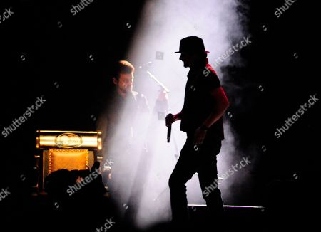 Kid Rock walks past the rocking chair left for George Jones after performing at the tribute concert for the late George Jones, in Nashville, Tenn. Jones had originally scheduled his final show for Friday. He died April 26