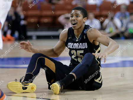 Colorado's Spencer Dinwiddie reacts to what he thought was a foul during the second half of a second-round game of the NCAA men's college basketball tournament, in Austin, Texas. Illinois defeated Colorado 57-49