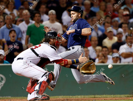 Luke Scott, Jarrod Saltalamacchia. Tampa Bay Rays' Luke Scott beats the throw into Boston Red Sox catcher Jarrod Saltalamacchia as he scores on a single by James Loney during the eighth inning of a baseball game at Fenway Park in Boston
