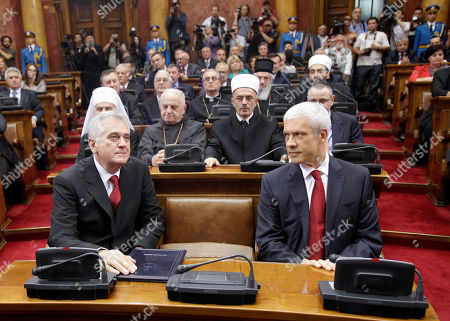 Tomislav Nikolic, Boris Tadic. Former Serbian President Boris Tadic, right, looks at new President Tomislav Nikolic during a parliament ceremony in Belgrade, Serbia, . Nikolic has been inaugurated as Serbia's new president, opening a period of political and economic uncertainty for the troubled Balkan country