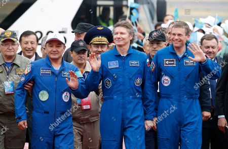Stock Image of Aidyn Aimbetov, Gennady Padalka, Andreas Mogensen. From left, Kazakhstan's Aidyn Aimbetov, Russia's Gennady Padalka and Denmark's Andreas Mogensen walk during a welcoming ceremony in Kazakhstan's capital Astana on . Russian Soyuz TMA-16M capsule landed safely in Kazakhstan, bringing home a three-person crew from the International Space Station, including a record-breaking Russian cosmonaut