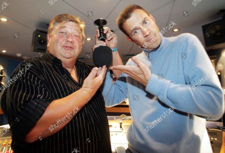 Jono Coleman And Johnny Vaughan. Jono And Johnny Get To Grips For Radio Aid They Are The Best Of Enemies On The Radio But Join Together For The Charity Broadcast.