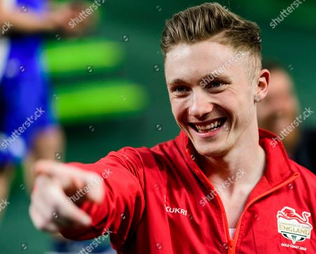Stock Picture of Nile Wilson of England celebrates winning the gold medal in the Men's Horizontal Bar Final on Day Five of the Gold Coast Commonwealth Games 2018.