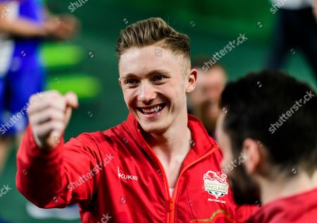 Stock Image of Nile Wilson of England celebrates winning the gold medal in the Men's Horizontal Bar Final on Day Five of the Gold Coast Commonwealth Games 2018.