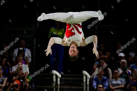 Stock Photo of Nile Wilson of England in action in the Men's Parallel Bar Final on Day Five of the Gold Coast Commonwealth Games 2018.