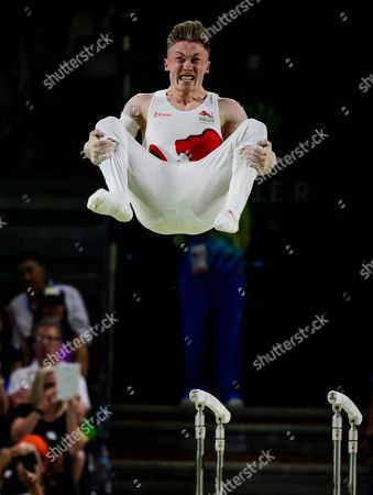 Nile Wilson of England in action in the Men's Parallel Bar Final on Day Five of the Gold Coast Commonwealth Games 2018.