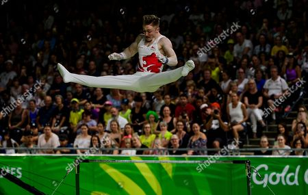 Nile Wilson of England in action in the Men's Horizontal Bar Final on Day Five of the Gold Coast Commonwealth Games 2018.
