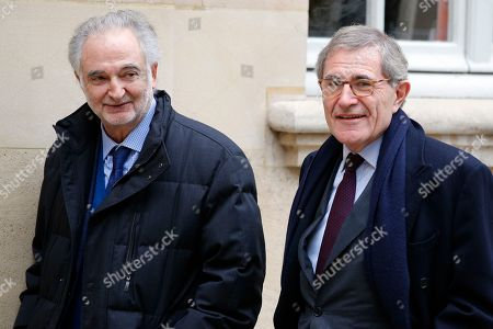 """France's economist and writer Jacques Attali, left, and French chairman of the board of directors and former CEO of energy giant Engie Gerard Mestrallet arrive for a meeting with Saudi Arabia Crown Prince Mohammed bin Salman and French Prime Minister Edouard Philippe in Paris, . Crown Prince Mohammed bin Salman is expected to sign a """"strategic partnership"""" with Macron in the Elysee Palace on Tuesday. France is hoping to profit from the prince's shake-up of the conservative kingdom to forge a new kind of commercial relationship"""