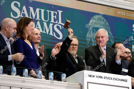 Stock Image of David Grinnell, Vice President of Brewing for the Boston Beer Company, gavels trading closed on the bell podium of the New York Stock Exchange, to highlight the launch of Samuel Adams' newest brewing innovation, Sam '76
