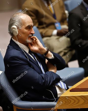 United Nations Ambassador from Syria Bashar Jaafari listen during a meeting of the U.N. Security council, at U.N. headquarters
