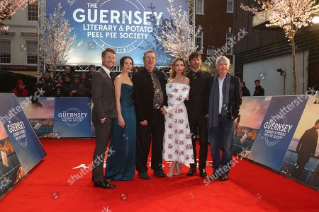 Glen Powell, Jessica Brown Findlay, Mike Newell, Lily James, Michiel Huisman, Tom Courtenay. Glen Powell, Jessica Brown Findlay, Mike Newell, Lily James, Michiel Huisman and Tom Courtenay pose for photographers upon arrival at the premiere of the film 'The Guernsey Literary and Potato Peel Pie Society' in London